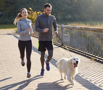 Realstar residents, professional adults jogging with dog, pet friendly apartments
