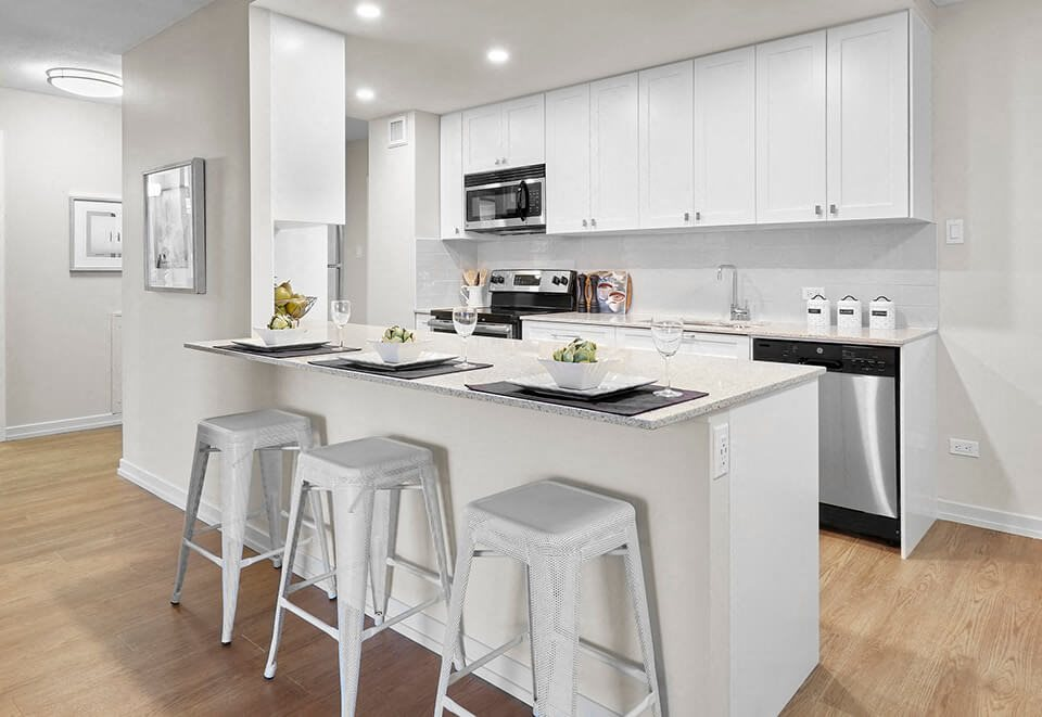 Panorama Apartments in Edmonton, ON kitchen with breakfast bar and upgraded cabinetry