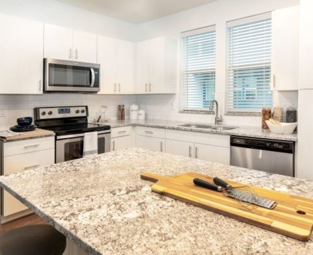 Efficient Appliances In Kitchen with window at Parc View Apartments & Townhomes, Utah