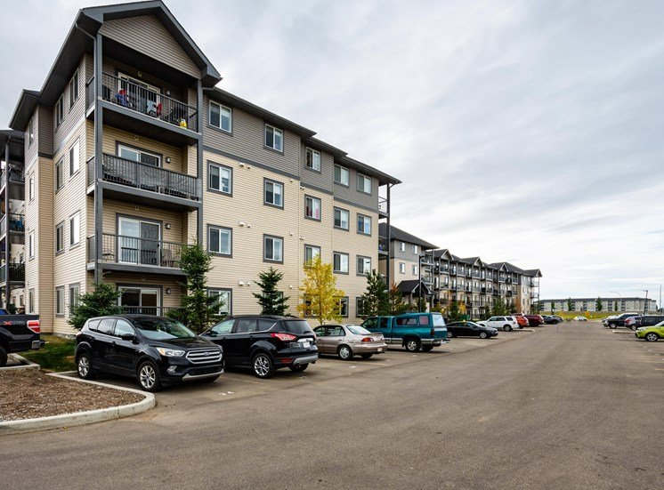 Entro residential rental apartments surface and visitor parking