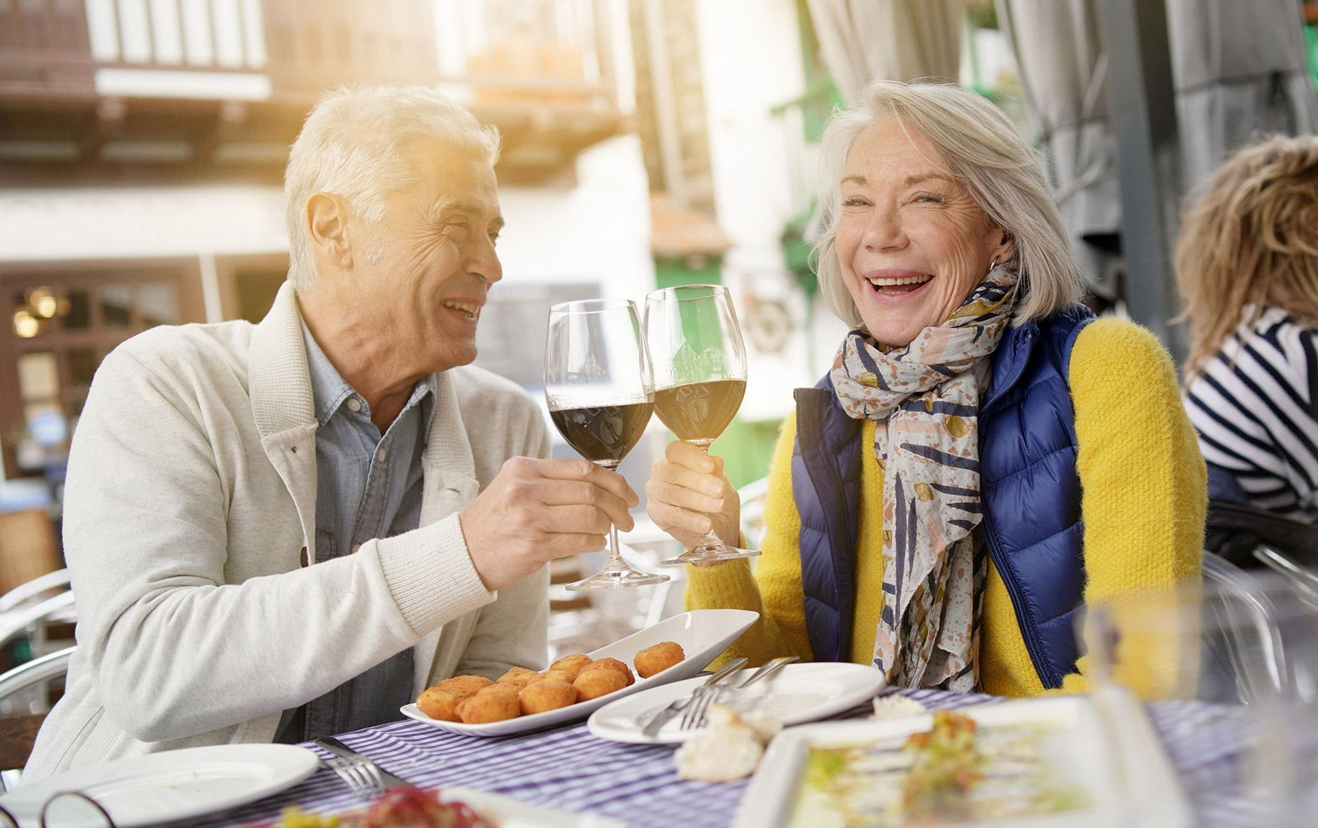 Happy Couple Enjoying Wine at Cogir of Stock Ranch, California, 95621