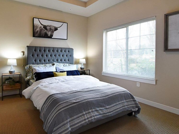 Bedroom With Expansive Windows at Cogir of Vancouver, Vancouver, 98682