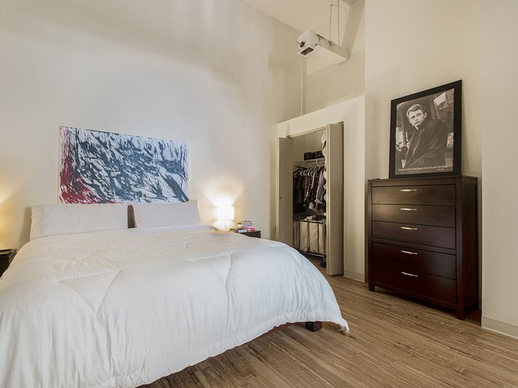 Denver Building Housing Furnished Bedroom Featuring High Ceilings