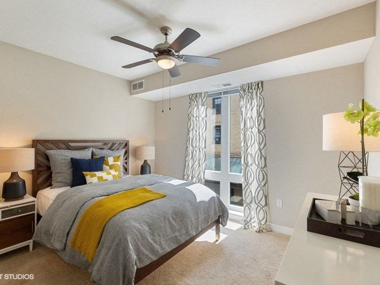 Large Bedroom with a Ceiling Fan and Overhead Lighting