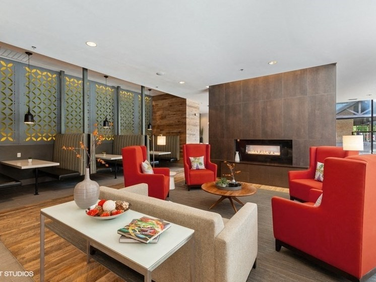 Modern Common Area with an Indoor Fireplace and Comfortable Seating