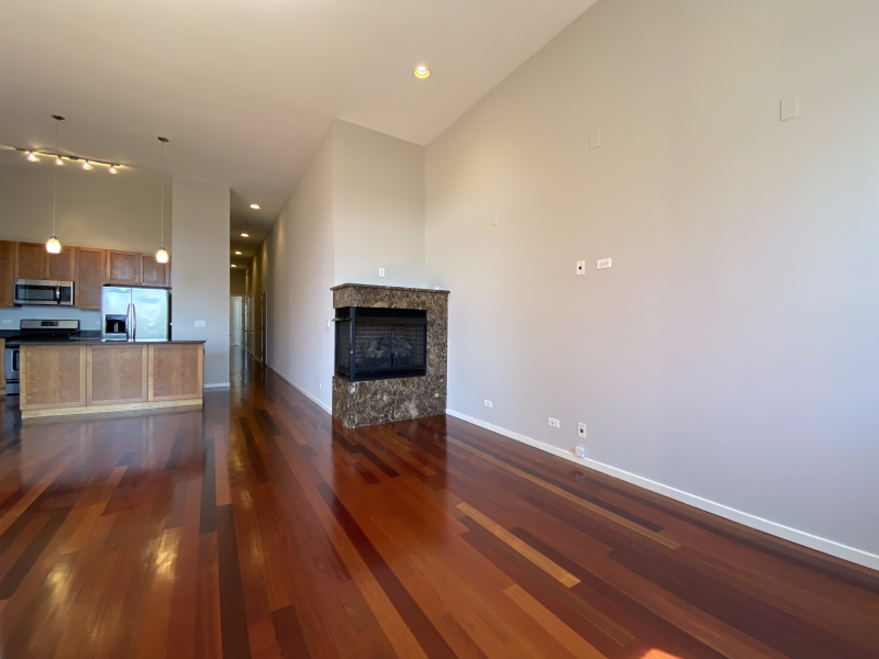 Spacious living area with hardwood floors and a built-in fireplace