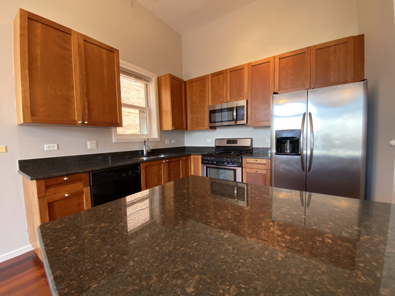 Stunning granite countertops in the large kitchen space