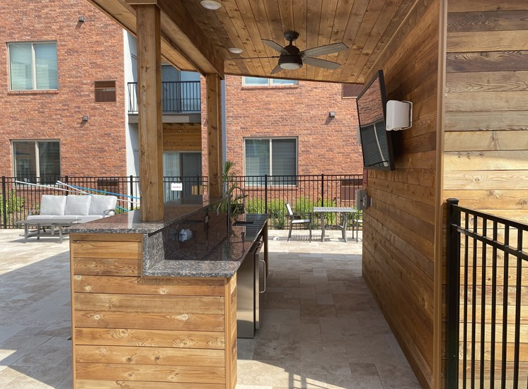 Outdoor bar area with large screen TV