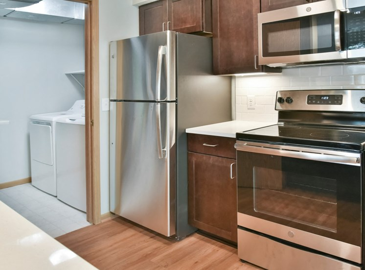 1 bedroom kitchen and laundry room with full size washer and dryer