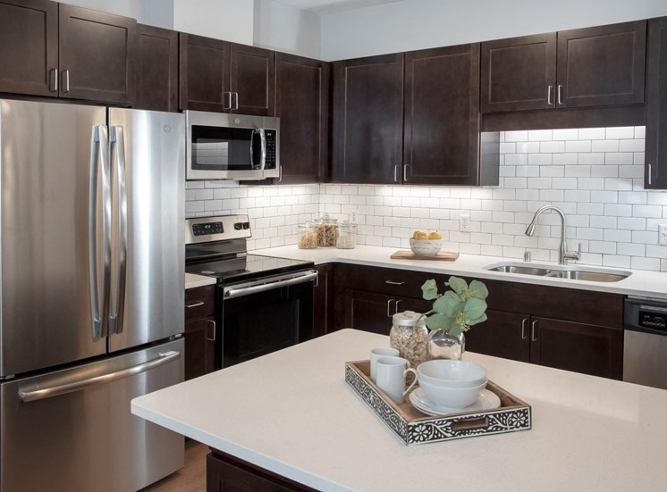 upgraded kitchens with breakfast bar in select townhomes