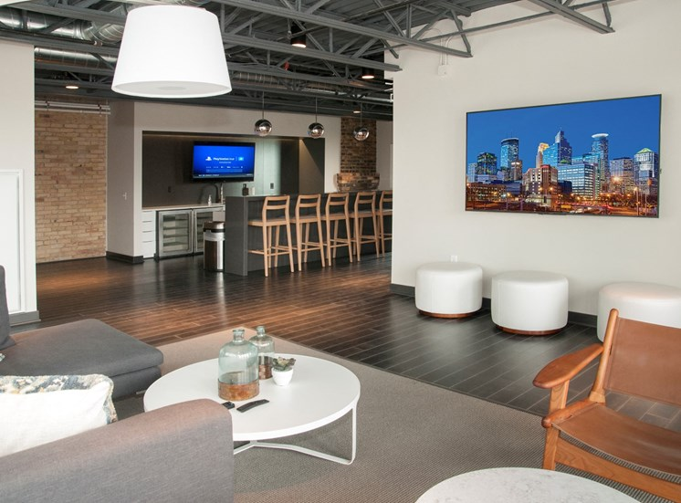 Community Room with Bar, Televisions and Seating Area at 700 Central Apartments, Minneapolis, MN