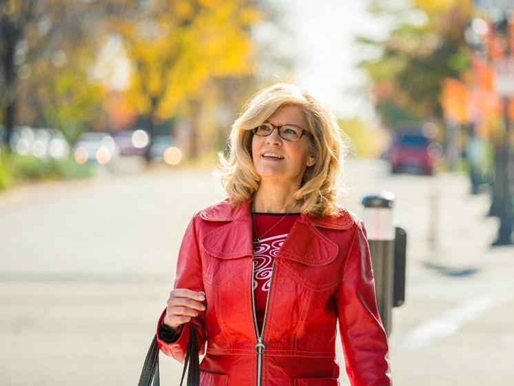 Woman enjoying a walk on sunny day in St Paul MN