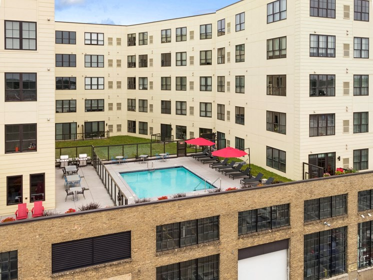 C&E Flats Roof Top Pool with Lounge Chairs and Patio Tables