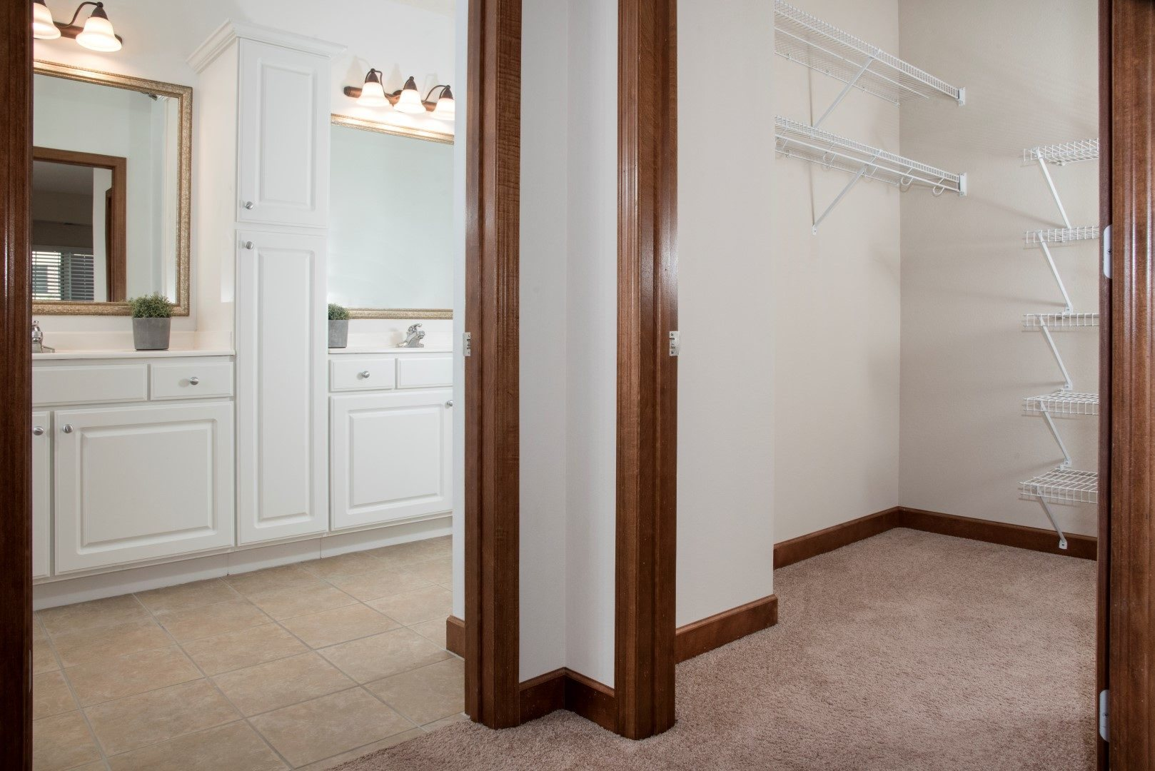 Walk-in closet with master bath and dual sink
