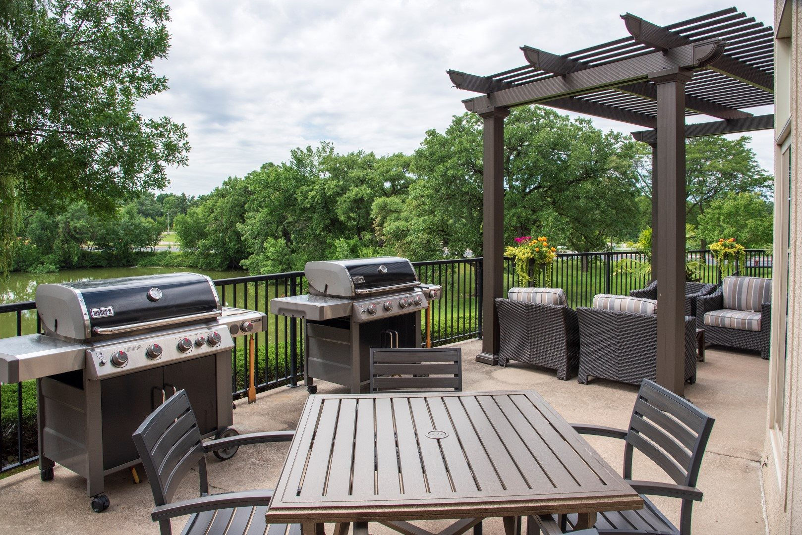Outdoor patio with gas grills and seating