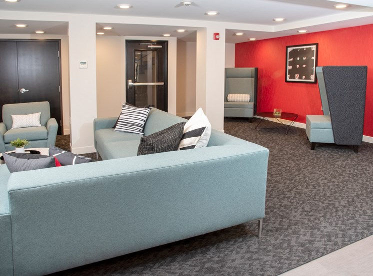 Community room  With couch and chairs at Eagan Place Apartments in Eagan, MN