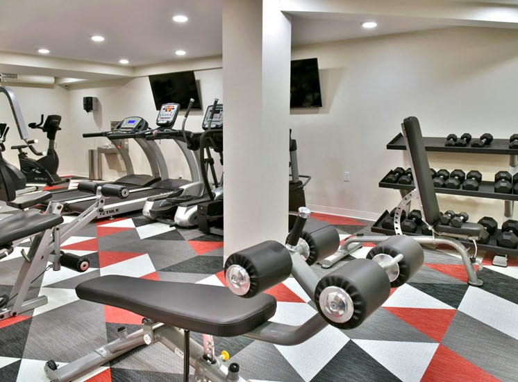 fitness room with weights and cardio machines