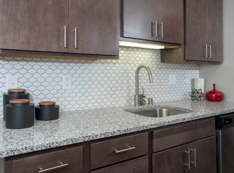 granite countertops, beautiful backsplash at Eagan Place Apartments, Eagan, MN