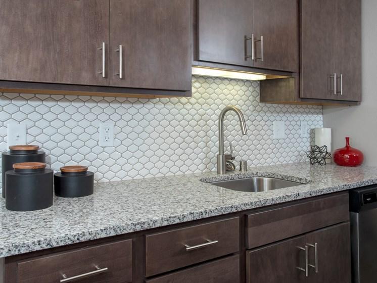 granite countertops, beautiful backsplash at Eagan Place Apartments, Eagan, MN