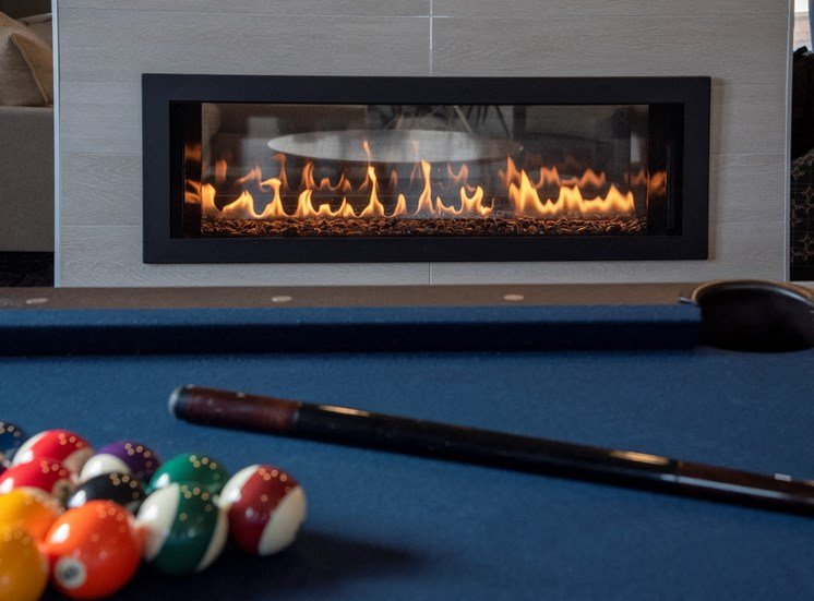 pool table and fireplace