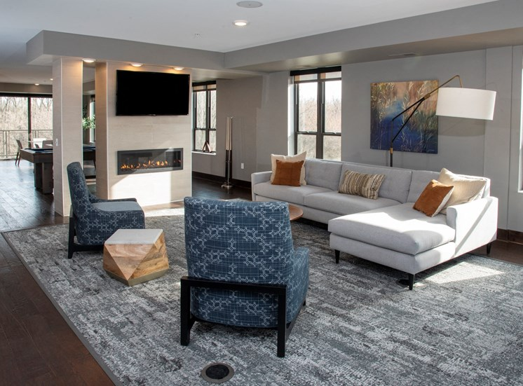 community room seating areas with tv and fireplace