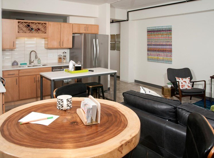 Corner Set Kitchen with Wooden Cabinetry and Stainless Steal Appliances at 700 Central Apartments