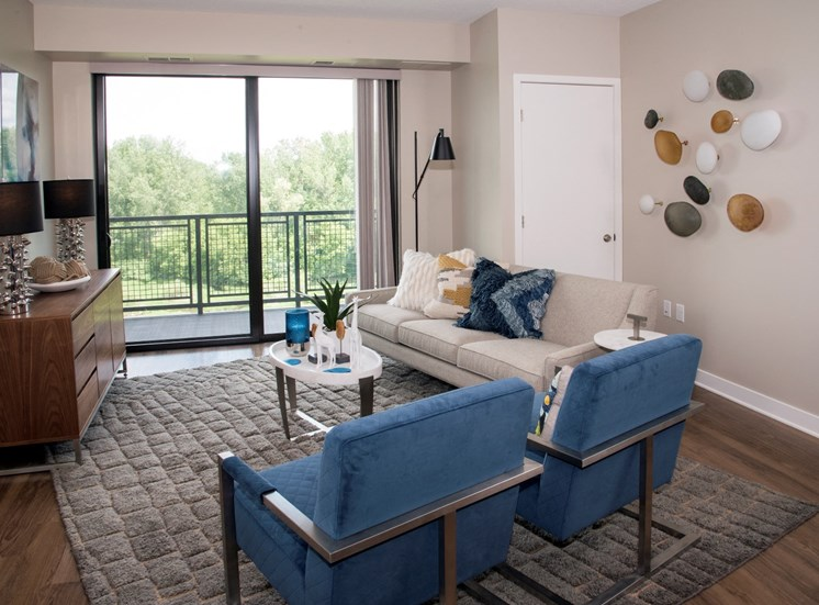Oversize windows for lots of natural light in living room at MartinBlu Apartments in Eden Prairie MN