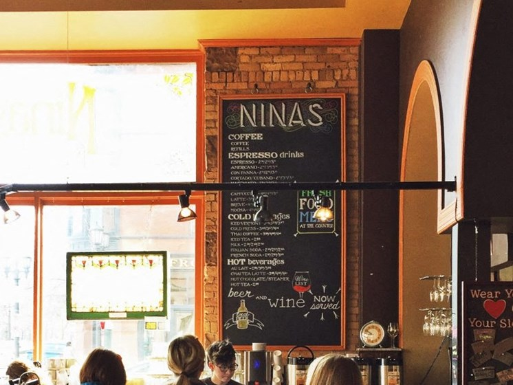 Grab a coffee or a bakery bite at Nina's Coffee Cafe near The Hill Apartments in St. Paul, MN