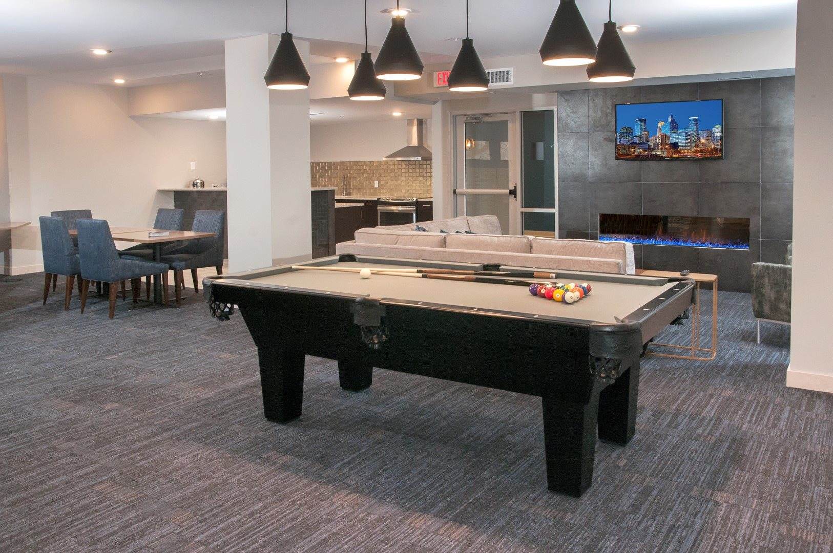 Game room with billiards and shuffleboard tables The Axis