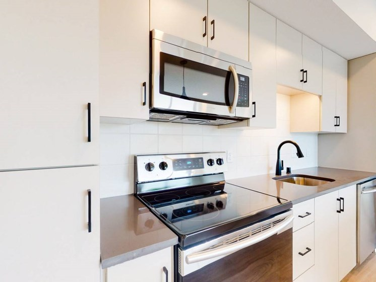 Modern Kitchen With Custom Cabinet at The Hill Apartments, Saint Paul, Minnesota