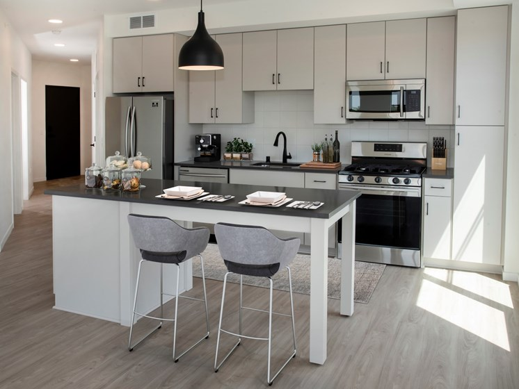 Fitted Kitchen With Island Dining at The Hill Apartments, Saint Paul