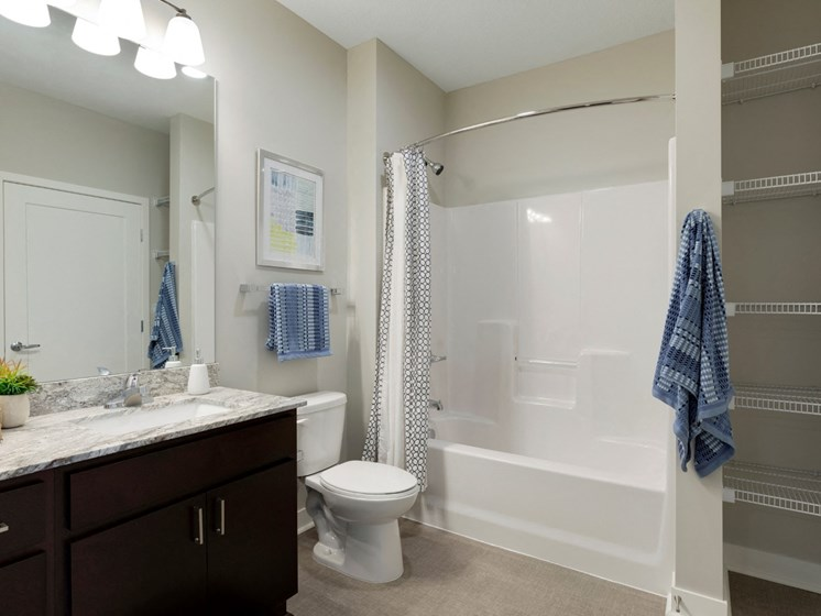 2nd bath w/dark cabinetry at the liberty apartments in golden valley mn