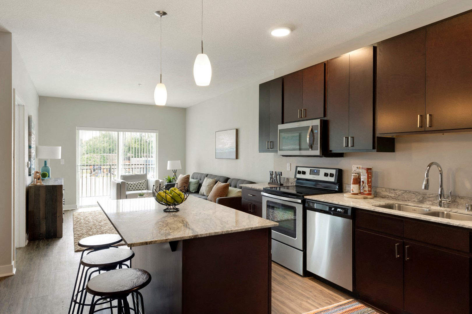 kitchen and living w/balcony at the liberty townhomes in golden valley mn