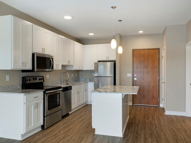 large kitchen w/island at the liberty apartments and town homes in golden valley mn