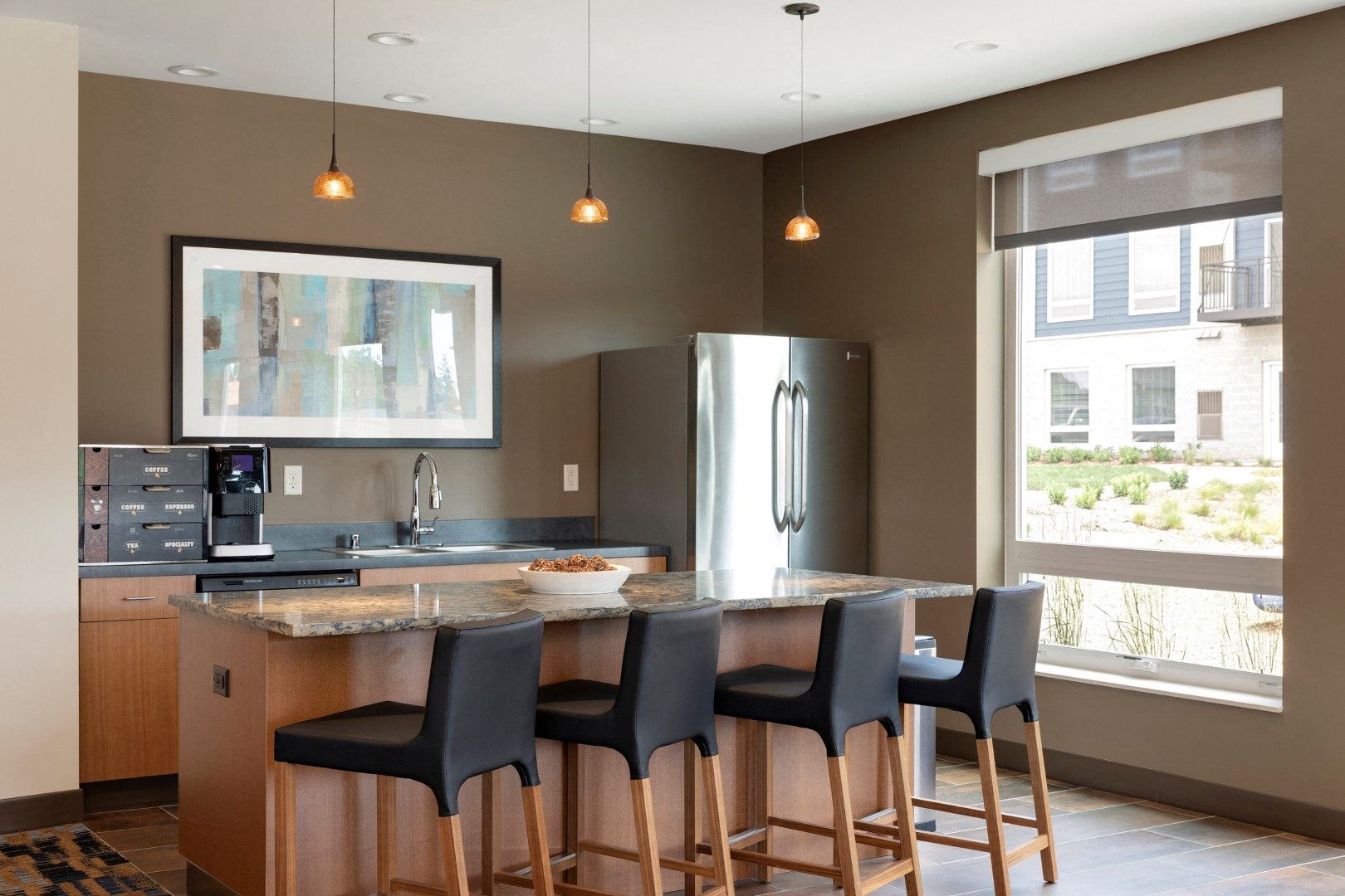 clubhouse kitchen area at the liberty town homes in golden valley mn