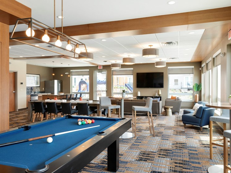 clubhouse with pool table at the liberty apartments and townhomes in golden valley mn