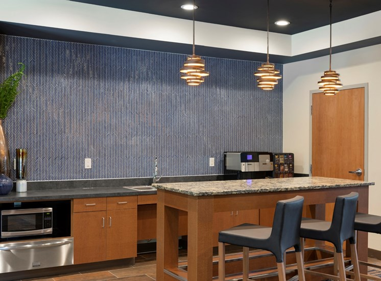 food prep and coffee area in clubroom at the liberty townhouses in golden valley mn