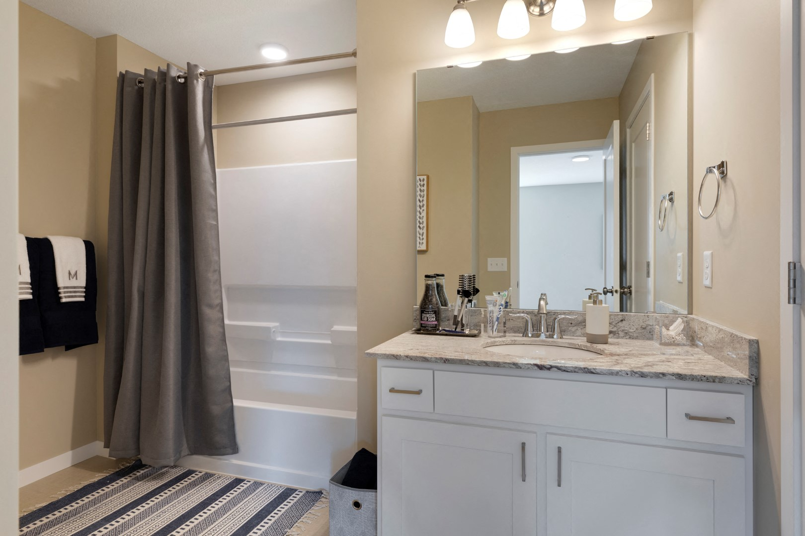 bathroom shower tub and vanity at the liberty apartments in golden valley minnesota