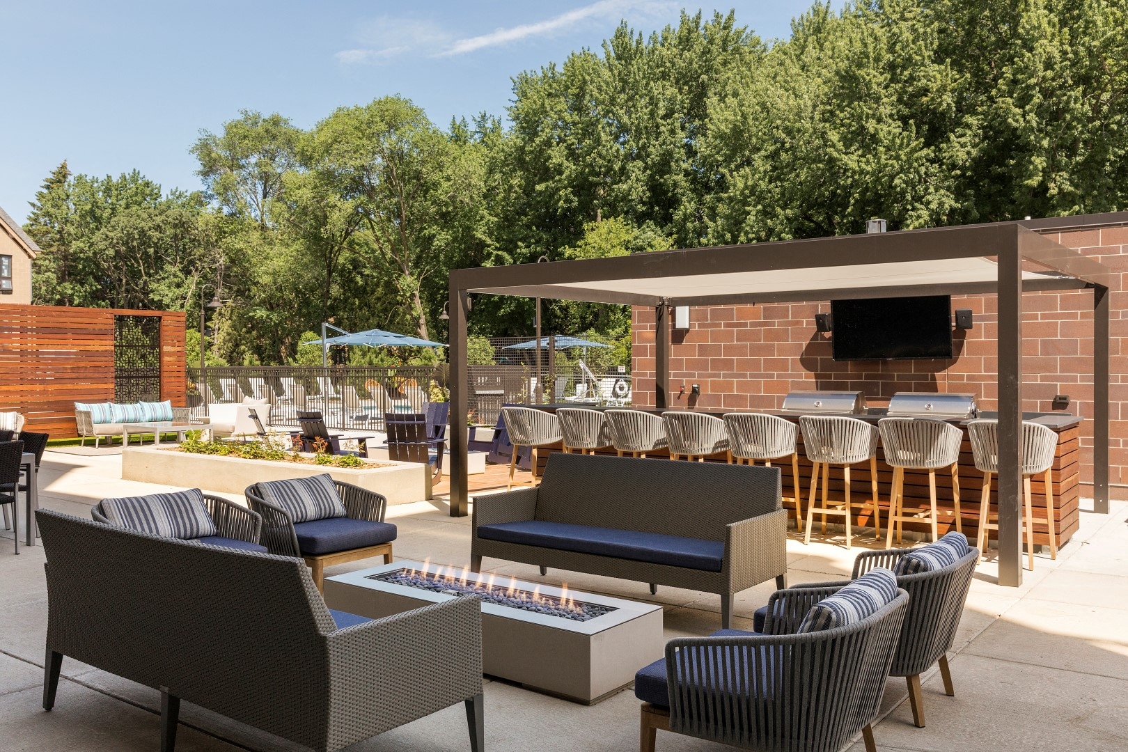 The McMillan Shoreview Exterior Sun Deck Pool Patio Grilling Area