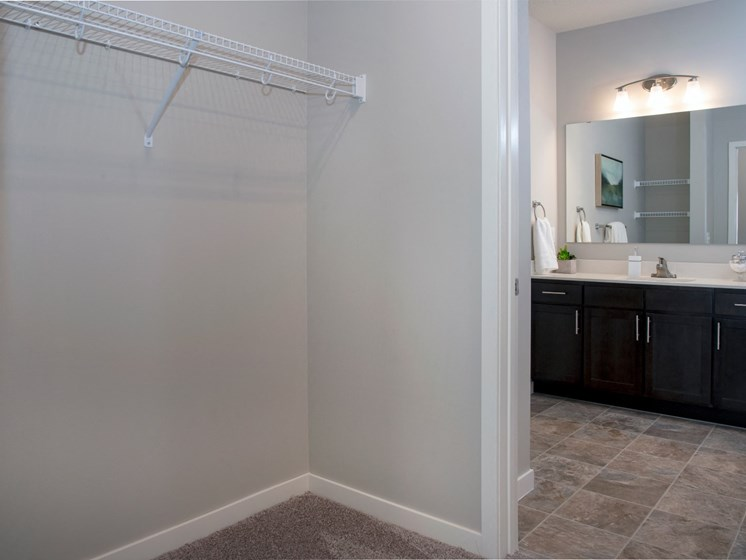 Large walk in closet and double vanity bathroom at The Sixton apartments in Shakopee, MN