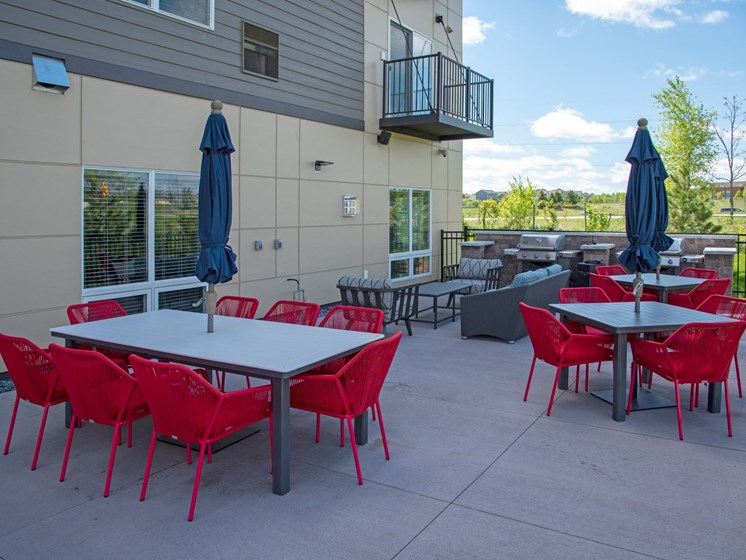 Community patio and grills at The Sixton
