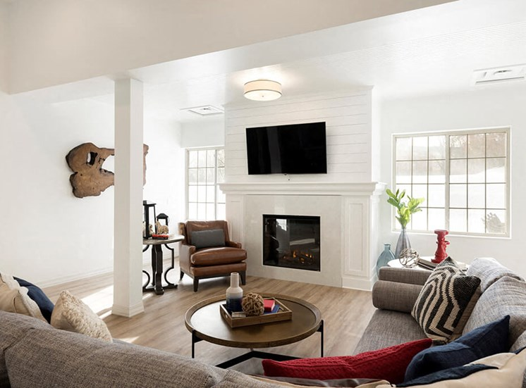 Large electric fireplace in clubroom of Waterstone Place