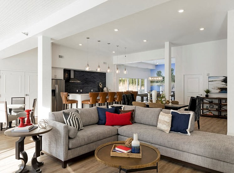 Bright clubroom with large grey sectional at Waterstone Place in Minnetonka, Mn