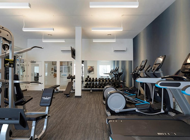Fitness center with machines, free weights and state of the art lifting stations at Waterstone Place