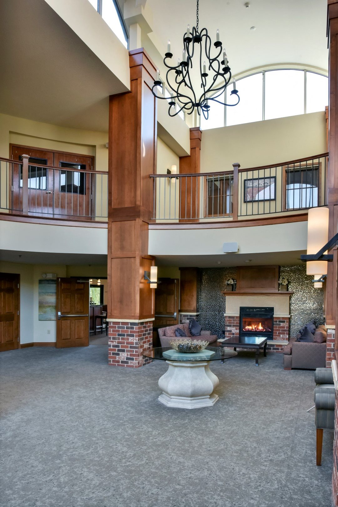 updated lobby with beautiful staircase and fireplace