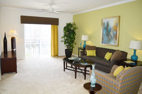 Living Room With Ceiling Fan and Door To Patio or Balcony
