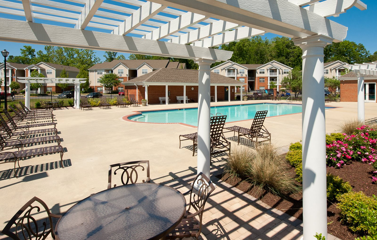 Pool With Cabanas and Chairs