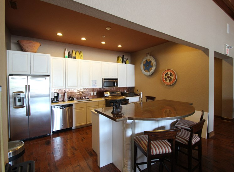 This is a picture of the full kitchen with island in the resident clubhouse at Nantucket Apartments, in Loveland, OH.