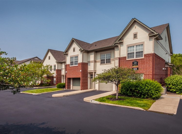 This is a photo of apartment exteriors showing attached garages at The Sanctuary at Fishers in Fishers, IN.