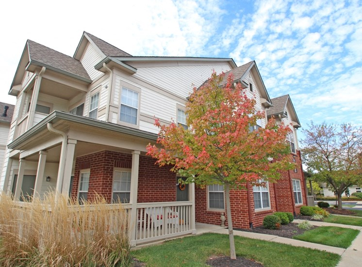This is a photo of apartment exteriors at The Sanctuary at Fishers in Fishers, IN.